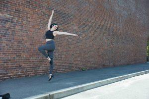 Avi jumping in a dance passe pose